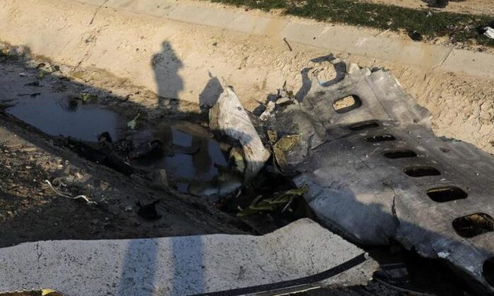 Debris is seen from an Ukrainian plane which crashed as authorities work at the scene in Shahedshahr, southwest of the capital Tehran, Iran, Wednesday, Jan. 8, 2020. A Ukrainian airplane carrying 176 people crashed on Wednesday shortly after takeoff from Tehran's main airport, killing all onboard. (Ebrahim Noroozi / AP)