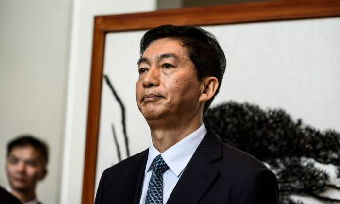 Luo Huining, the new head of the Chinese liaison office in Hong Kong, speaks briefly with the media in Hong Kong on January 6, 2020. (STR/AFP via Getty Images)