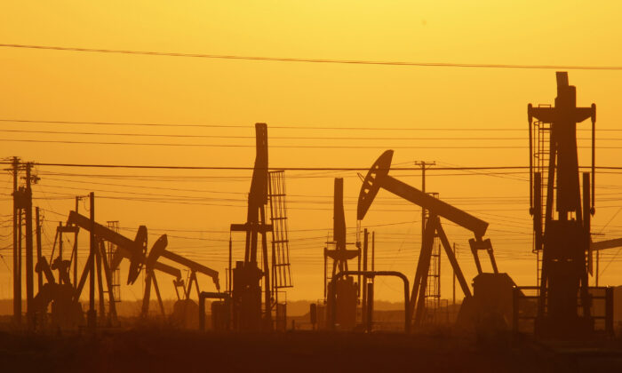 Pump jacks are seen at dawn in an oil field over the Monterey Shale formation near Lost Hills, Calif., on March 24, 2014.  David McNew/Getty Images