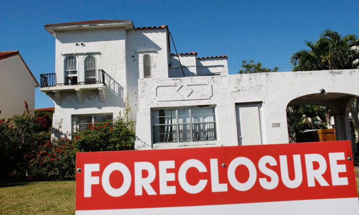 A foreclosure sign stands in front of a home in Miami Beach, Fla., on Jan. 22, 2009.  Joe Raedle/Getty Images