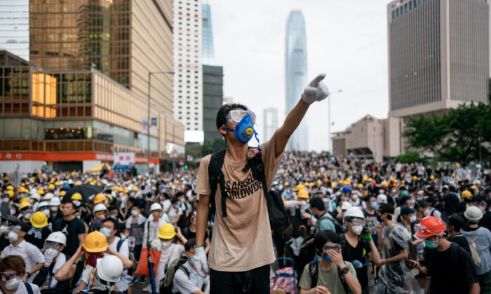 A protester makes a gesture during a protest in Hong Kong, China, on June 12, 2019. Large crowds of protesters gathered in central Hong Kong as the city braced for another mass rally in a show of strength against the government over a divisive plan to allow extraditions to China.  Anthony Kwan/Getty Images