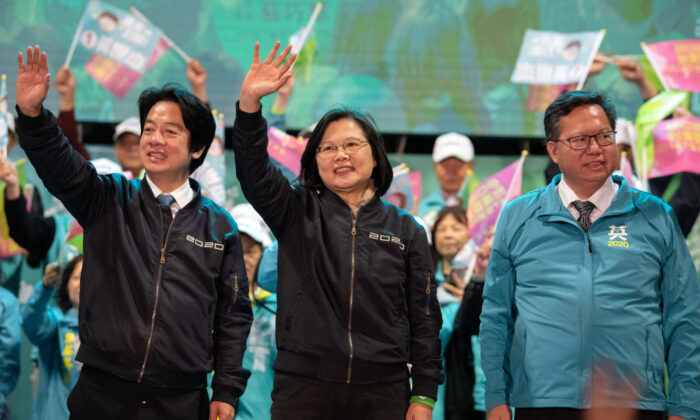 Taiwanese President Tsai Ing-wen (C) and her running mate William Lai (L) wave to supporters during a rally in Taoyuan, Taiwan, on Jan. 8, 2020. (Carl Court/Getty Images)