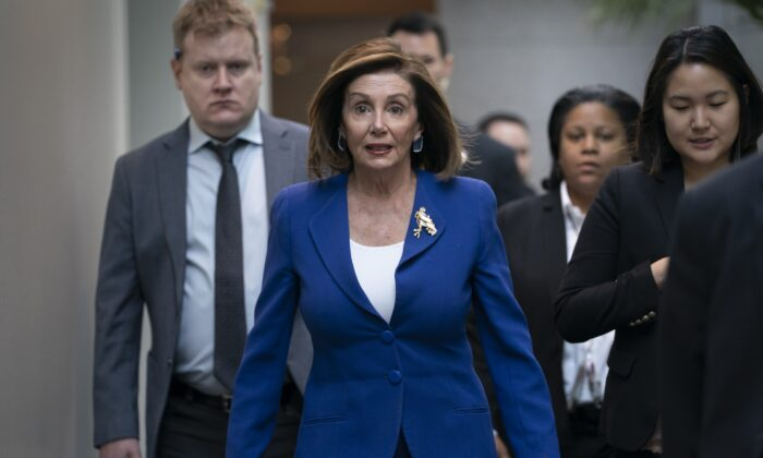 House Speaker Nancy Pelosi (D-Calif.) arrives to meet with other House Democrats on the morning following Iranian attacks on bases in Iraq housing U.S. troops, at the Capitol in Washington on Jan. 8, 2020. (J. Scott Applewhite/AP Photo)