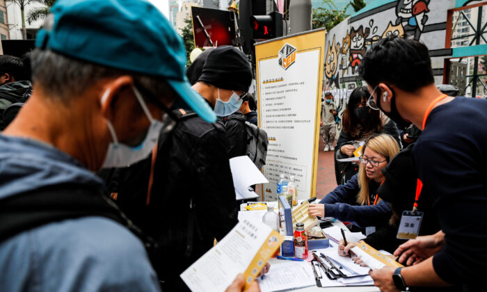 Protesters queue up at a booth of Hong Kong Construction and Engineering Employees General Union to apply for membership during pro-democracy protests on New Year's Day, to call for better governance and democratic reforms in Hong Kong, China, on Jan. 1, 2020. (Tyrone Siu/Reuters)