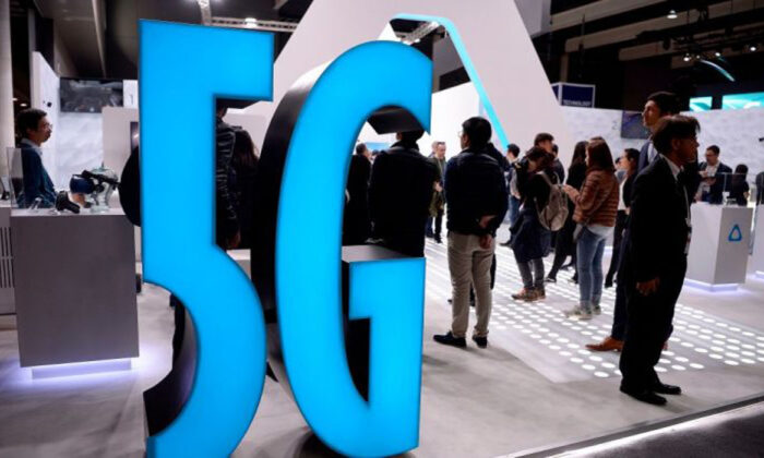 A 5G sign is displayed at a stand at the Mobile World Congress (MWC) in Barcelona, Spain, on Feb. 25, 2019. (Josep Lago/AFP/Getty Images)