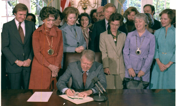 President Jimmy Carter signs H.J.Res.638 extending the deadline for the ratification of the Equal Rights Amendment on Oct. 20, 1978.  (U.S. National Archives and Records Administration via Wikimedia Commons)