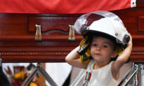 Daughter of Fallen Firefighter Dons Father's Helmet at His Funeral, Receives His Medal for Bravery