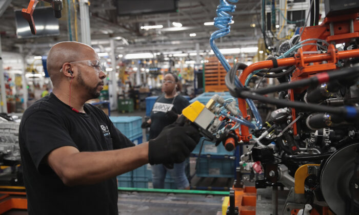 Workers assemble Ford vehicles at the company's Chicago assembly plant on June 24, 2019.   Scott Olson/Getty Images