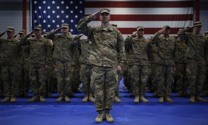 U.S. Army soldiers salute during the playing of the Star Spangled Banner during a homecoming ceremony in the Natcher Physical Fitness Center on Fort Knox, Ky., on Feb. 27, 2014.  (Luke Sharrett/Getty Images)