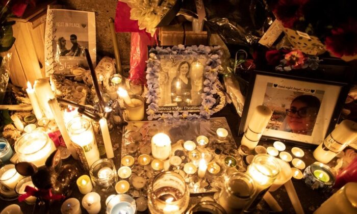 Photographs are left among candles at a memorial during a vigil in Toronto on Jan. 9, 2020, to remember the victims of the Iranian air crash. (The Canadian Press/Chris Young)