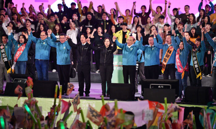 Taiwan's current president and Democratic Progressive Party presidential candidate, Tsai Ing-wen (in black) stands with party colleagues on stage during a rally ahead of Saturday's presidential election in Taipei, Taiwan, on Jan. 10, 2020. (Carl Court/Getty Images)