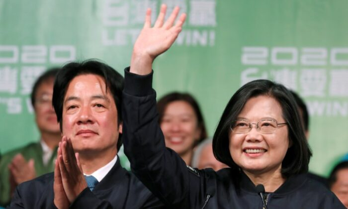 Incumbent Taiwan President Tsai Ing-wen and Vice President-elect William Lai wave to their supporters after their election victory at a rally, outside the Democratic Progressive Party (DPP) headquarters in Taipei, Taiwan Jan. 11, 2020. (Reuters/Tyrone Siu)