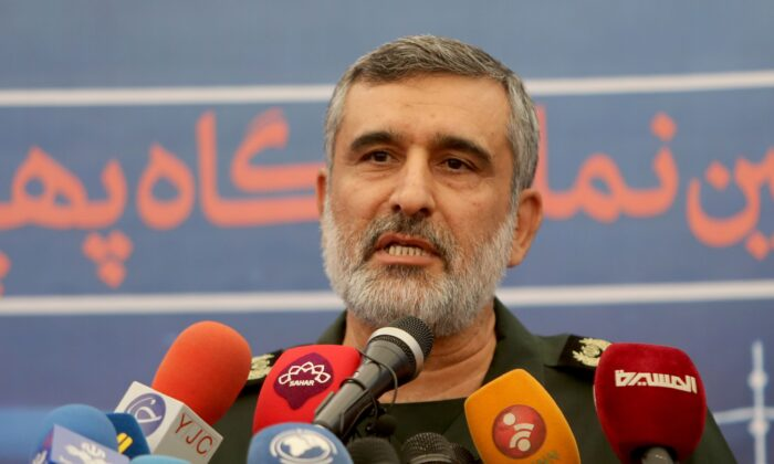General Amir Ali Hajizadeh, the head of the Revolutionary Guard's aerospace division, speaks at Tehran's Islamic Revolution and Holy Defence museum, during the unveiling of an exhibition of what Iran says are US and other drones captured in its territory, in the capital Tehran on Sept. 21, 2019. (Photo by Atta Kenare/AFP via Getty Images)