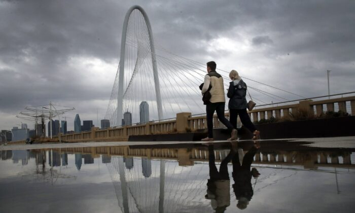 Clouds from a passing shower move across the Dallas skyline and the Margaret Hunt Hill Bridge on Jan. 10, 2020. (Tom Fox/The Dallas Morning News via AP)