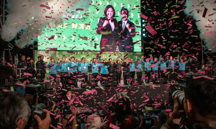 Confetti falls as Tsai Ing-Wen holds hands with Vice President-elect William Lai and Vice-President, Chen Chien-jen, as she celebrates after addressing supporters following her re-election as President of Taiwan in Taipei, Taiwan on January 11, 2020. (Carl Court/Getty Images)