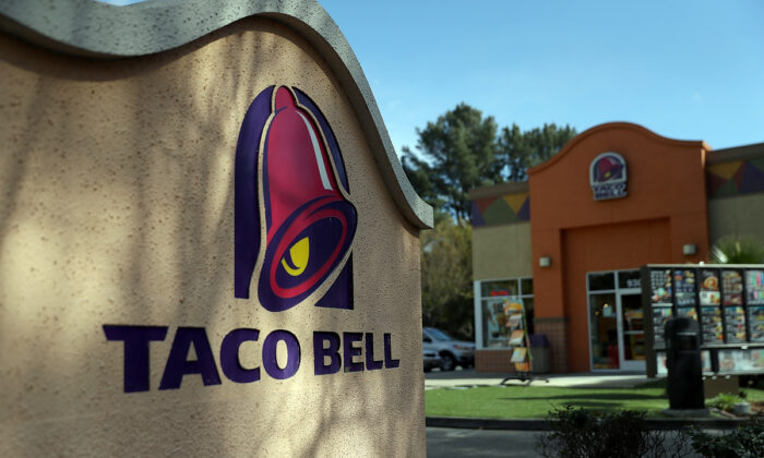 A sign is posted in front of a Taco Bell restaurant in Novato, Calif., on Feb. 22, 2018.  Justin Sullivan/Getty Images