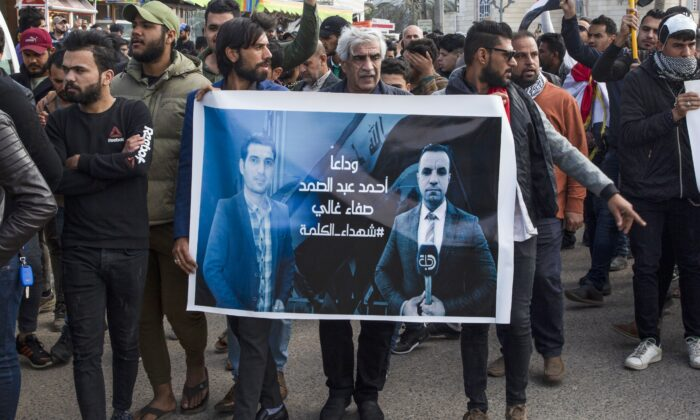 Iraqis take part in a rally on Jan. 11, 2020, to mourn two reporters (image) shot dead the previous evening in the country's southern city of Basra, where they had been covering months of anti-government protests. (HUSSEIN FALEH/AFP via Getty Images)