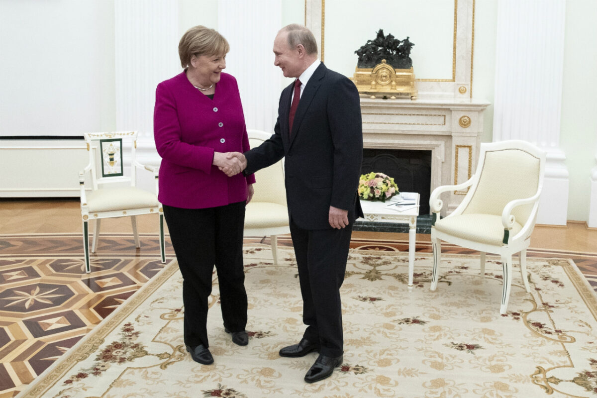 Russian President Vladimir Putin, right, and German Chancellor Angela Merkel greet each other prior to the talks in the Kremlin in Moscow, Russia, Saturday, Jan. 11, 2020 (Pavel Golovkin, Pool/AP Photo)