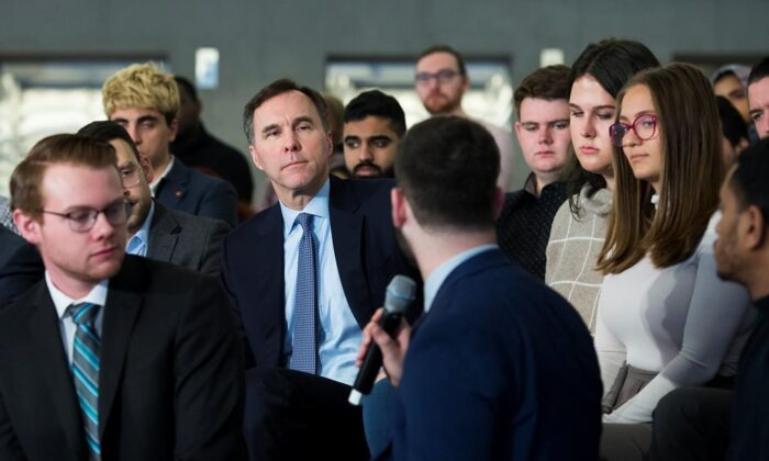 Canadian federal Finance Minister BillMorneau (back centre) listens to a question from a Ryerson University student as he launches consultations for Budget 2020 at a town hall discussion in Toronto on Jan. 13, 2020. (The Canadian Press/Nathan Denette)