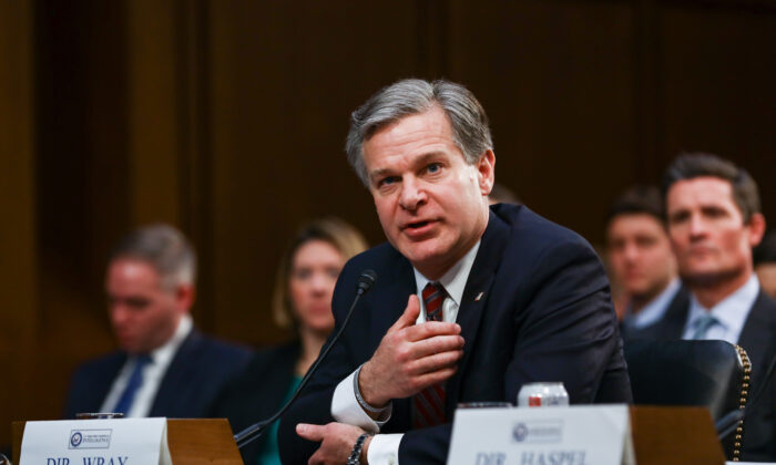 FBI Director Christopher Wray testifies at a hearing in front of the Senate Intelligence Committee in Congress in Washington on Jan. 29, 2019. (Charlotte Cuthbertson/The Epoch Times)