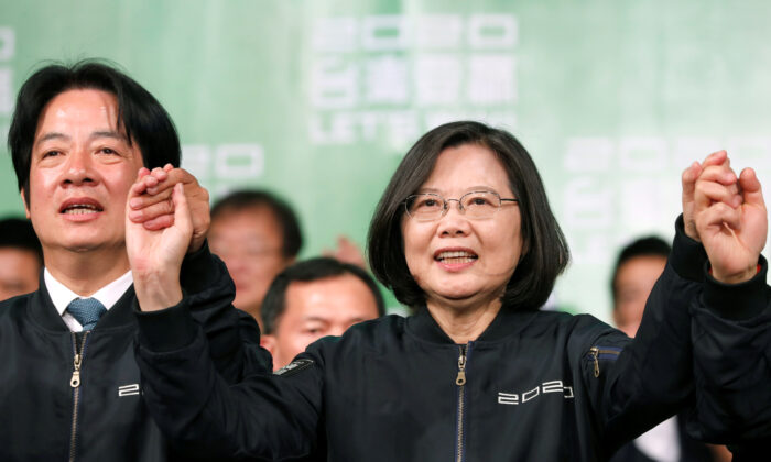 Incumbent Taiwan President Tsai Ing-wen and Vice President-elect William Lai attend a rally after their election victory, outside the Democratic Progressive Party (DPP) headquarters in Taipei, Taiwan on Jan. 11, 2020. (Tyrone Siu/Reuters)