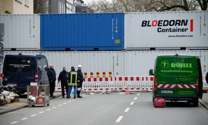A road is blocked with containers in Dortmund, Germany, on Jan. 12, 2020. (Henning Kaiser/dpa via AP)
