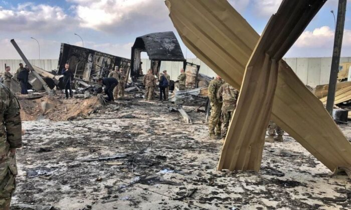 U.S. soldiers and journalists inspect the rubble at a site of Iranian bombing, in Ain al-Asad air base, Anbar, Iraq, on Jan. 13, 2020. (Qassim Abdul-Zahra/AP Photo)