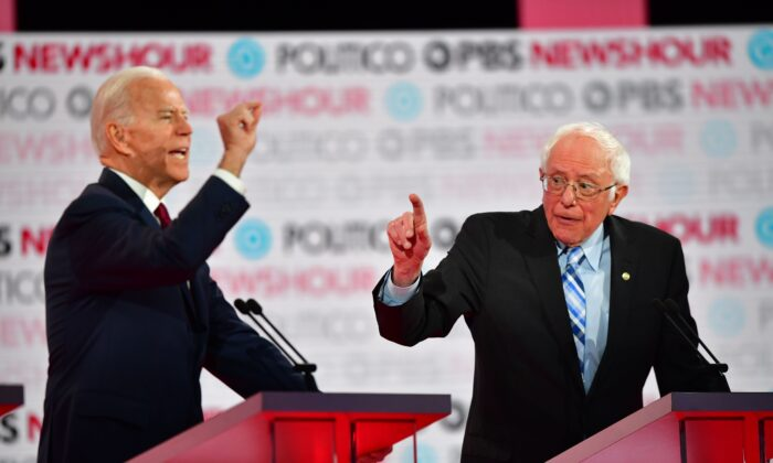 Democratic presidential hopeful former Vice President Joe Biden (L) and Sen. Bernie Sanders (I-Vt.) participate in the sixth Democratic primary debate of the 2020 presidential campaign season at Loyola Marymount University in Los Angeles, California, on Dec. 19, 2019. (Frederic J. Brown/AFP via Getty Images)