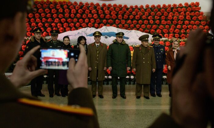 Soldiers from Russia, Iran, and China and North Korea pose for a photo before a display during a 'Kimjongilia' flower exhibition celebrating late leader Kim Jong Il, in Pyongyang, North Korea on Feb. 14, 2019. (Ed Jones/AFP via Getty Images)