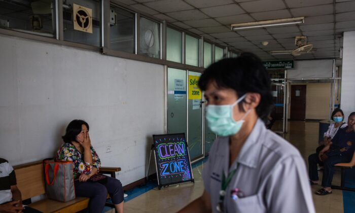 """A nurse walks past a """"clean zone,"""" a room with purified air for respiratory illness patients, at the Suan Dok Hospital in Chiang Mai, Thailand on April 22, 2019. (Lauren DeCicca/Getty Images)"""