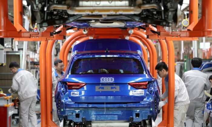Workers work on an assembly line manufacturing Audi Q3 cars at the FAW-Volkswagen Tianjin plant in Tianjin, China on Dec. 5, 2019. (Reuters)