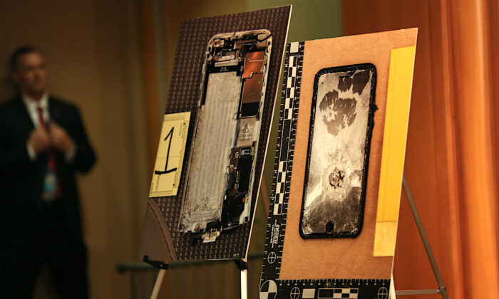 Images of two Apple iPhones that the Pensacola naval base shooter, Royal Saudi Air Force 2nd Lt. Mohammed Alshamrani, tried to destroy are on display at a press conference at the Justice Department in Washington on Jan, 13, 2020. (Charlotte Cuthbertson/The Epoch Times)