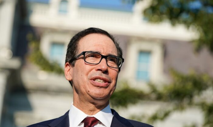 Secretary of the Treasury Steven Mnuchin answers questions from the press after an interview on CNBC on the North Lawn of the White House in Washington on Sept. 12, 2019. (Sarah Silbiger/Reuters)