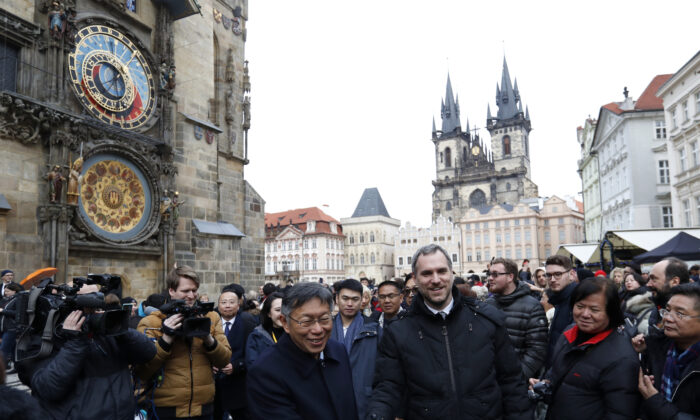 Mayor of Prague Zdenek Hrib, left, and Taipei city mayor Ko Wen-je shake hands before signing a partnership agreement between the two cities at the Old Town Square in Prague, Czech Republic, on Jan. 13, 2020. (Petr David Josek/AP)