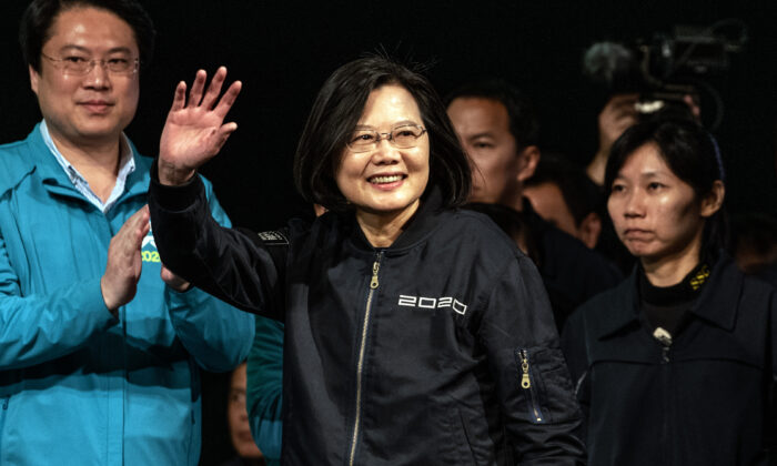 Tsai Ing-Wen waves as she walks on stage to address supporters after being re-elected as President of Taiwan in Taipei, Taiwan on Jan. 11, 2020. (Carl Court/Getty Images)