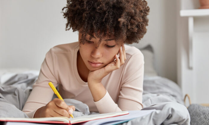 Each night, take time to write down what's on your mind. Somehow, getting it down on paper allows your mind to relax. (Shutterstock)