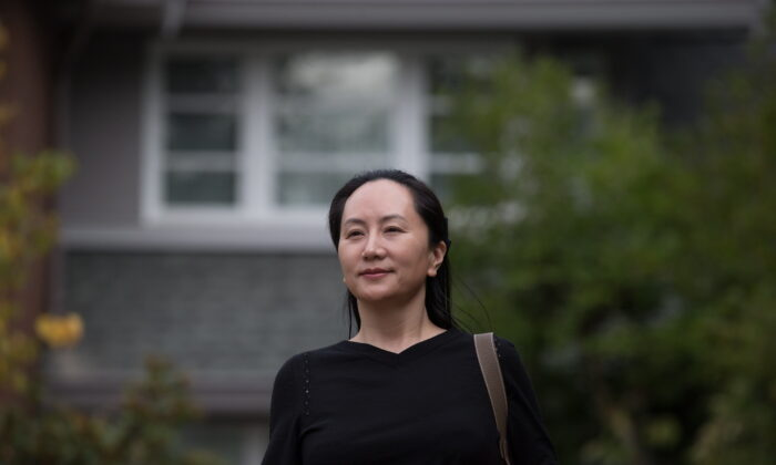 Huawei chief financial officer Meng Wanzhou leaves her home to attend a court hearing in Vancouver on Oct. 2, 2019. (The Canadian Press/Darryl Dyck)