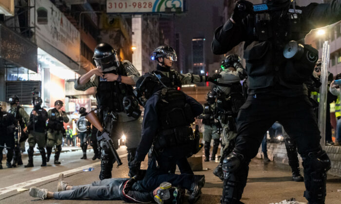 Riot police detain a protesters during a rally in Causeway Bay district on New Years Day on Jan. 1, 2020 in Hong Kong, China. (Anthony Kwan/Getty Images)