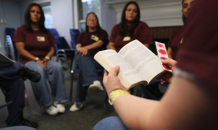 Prison inmates hold a meeting on addiction while at the York Community Reintegration Center in Niantic, Conn., on May 24, 2016.  John Moore/Getty Images