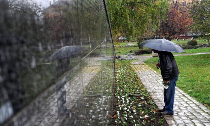 A man searches for his relatives' names on a monument with the names of some 20,000 victims of communist rule, in downtown Sofia, Bulgaria, in a file photo. (Dimitar Dilkoff/AFP via Getty Images)