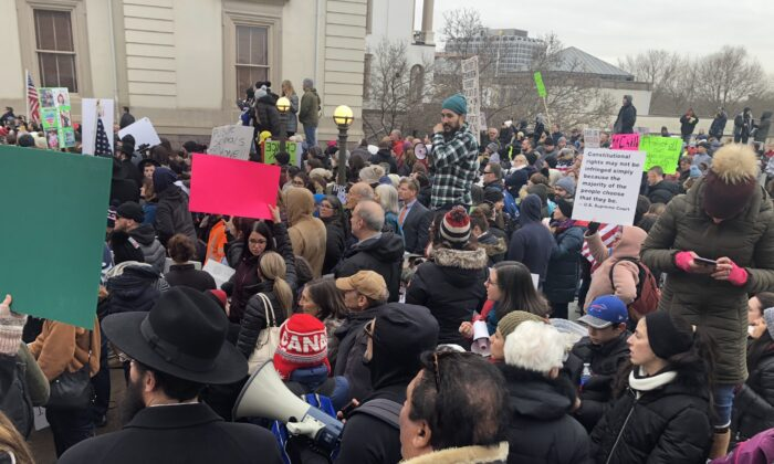 Protesters against a bill that would end religious exemptions for vaccines stand outside the New Jersey State House in Trenton, N.J. on Jan. 13, 2020. (Celia Farber/The Epoch Times)