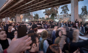 Unprecedented Iran Protests Target Islamic Regime, Experts Say