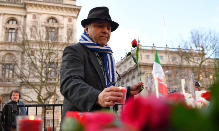 Demonstrators from the Anglo-Iranian Communities in the UK attend a vigil opposite the gates of 10 Downing Street in central London on Jan. 10, 2020, for the victims of the Ukrainian airliner which was downed by Iranian military on Jan. 8, killing all 176 onboard. (Ben Stansall/AFP via Getty Images)