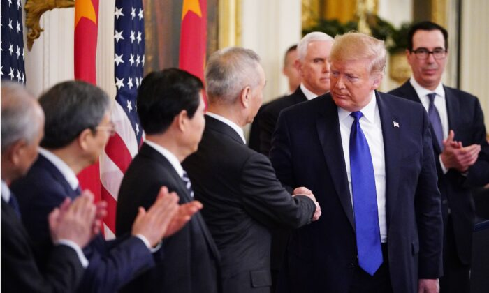 US President Donald Trump (R) and China's Vice Premier Liu He, the country's top trade negotiator, shake hands before signing a trade agreement between the US and China during a ceremony in the East Room of the White House in Washington, DC on Jan. 15, 2020. (Mandel Ngan/AFP via Getty Images)