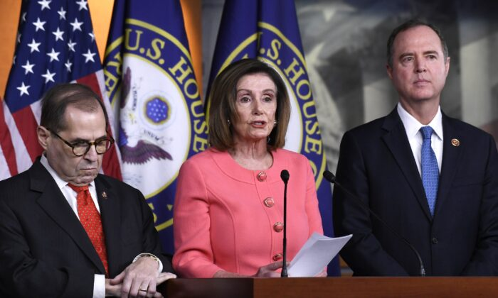 House Speaker Nancy Pelosi (D-Calif.) (C), flanked by House Judiciary Committee Chairman Rep. Jerrold Nadler (D-N.Y.) (L) and House Intelligence Committee Chairman Rep. Adam Schiff (D-Calif.) (R), speaks during a news conference to announce impeachment managers on Capitol Hill in Washington on Jan. 15, 2020. (Susan Walsh/AP Photo)