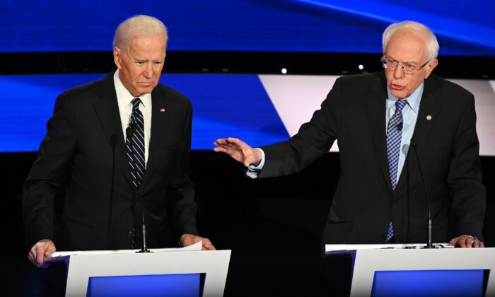 Democratic presidential hopefuls Former Vice President Joe Biden, left, and Sen. Bernie Sanders (I-Vt.) participate of the seventh Democratic primary debate of the 2020 presidential campaign season at the Drake University campus in Des Moines, Iowa on Jan. 14, 2020. (Robyn Beck/AFP via Getty Images)