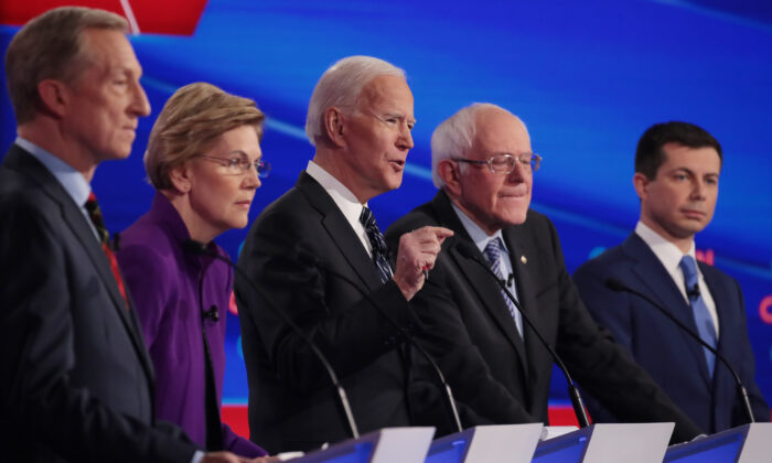 Tom Steyer (L), Sen. Elizabeth Warren (D-MA),  Sen. Bernie Sanders (I-VT) and former South Bend, Indiana Mayor Pete Buttigieg (R) listen as former Vice President Joe Biden (C) speaks during the Democratic presidential primary debate at Drake University on January 14, 2020 in Des Moines, Iowa.  Six candidates out of the field qualified for the first Democratic presidential primary debate of 2020, hosted by CNN and the Des Moines Register.  (Photo by Scott Olson/Getty Images)