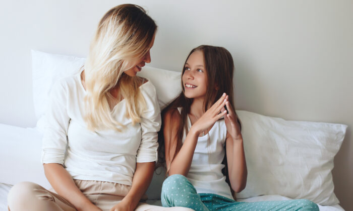 A mother sees her daughter as a mini version of her and can play a mentoring role for her, including modeling a healthy self-image. (Alena Ozerova/Shutterstock)