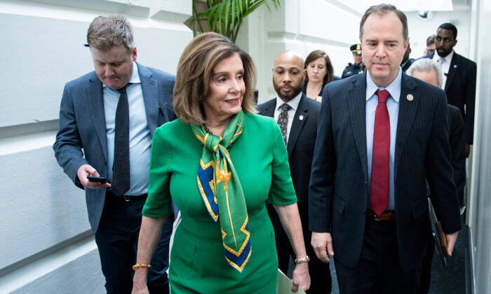 House Speaker Nancy Pelosi (D-Calif.) and House Intelligence Committee Chairman Adam Schiff (D-Calif.) leave after a caucus meeting with House Democrats on Capitol Hill in Washington on Jan. 14, 2020. (Brendan Smialowski/AFP via Getty Images)