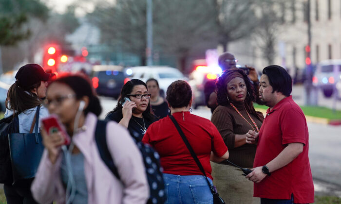 People wait outside Bellaire High School after a shooting on Jan. 14, 2020, in Bellaire, Texas. (Melissa Phillip/Houston Chronicle via AP)